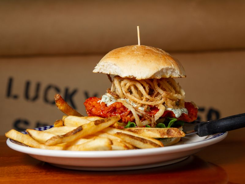 Buffalo crab burger with french fries